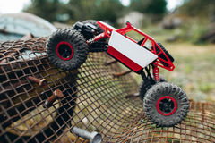 Toy truck overcoming grille with screws profile Royalty Free Stock Photography