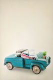 Toy truck packed with colorful furniture Royalty Free Stock Photos