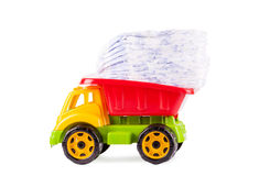 Toy truck with a pile of diapers Royalty Free Stock Photo