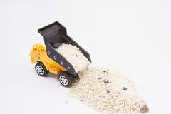 Toy truck pouring sand Royalty Free Stock Photo