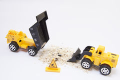 Toy truck pouring sand Stock Photo