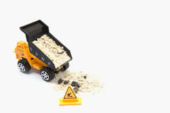 Toy truck pouring sand Royalty Free Stock Images