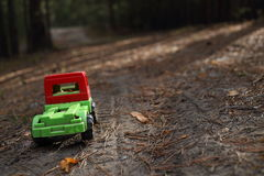 Toy truck on a shady forest road Stock Photos