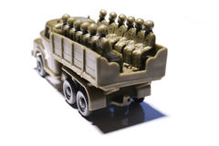Toy truck with soldiers. Close up of plastic toy truck with two rows of soldiers sitting Royalty Free Stock Photography
