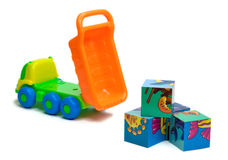 Toy truck unloading bricks. Colorful toy truck unloading bricks Royalty Free Stock Photo