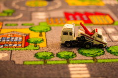Toy trucks on toy matt Royalty Free Stock Photos