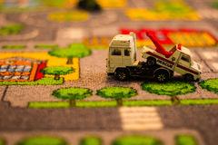 Toy trucks on toy matt Stock Photography