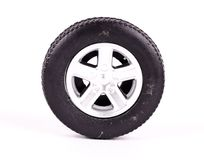 A toy Tyre wheel with alloys. On an isolated background stock photo