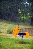 Toy under the rain. The rain prevents the normal use of outdoor toys Royalty Free Stock Image