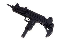 Toy Uzi machine gun. Plastic toy Uzi sub-machine gun isolated over white Royalty Free Stock Photos