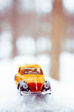 Toy Volkswagen Beetle in Snow Stock Image