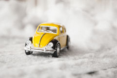 Toy Volkswagen Beetle in Snow Royalty Free Stock Image
