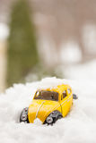 Toy Volkswagen Beetle in Snow Royalty Free Stock Photography