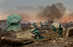 Toy warfield. Green plastic soldiers attack war scene Royalty Free Stock Image