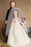 Toy wedding. Wedding photo, two little dolls stock photos