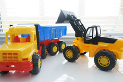 Toy Wheel Loader and Toy Dump Truck Stock Photos