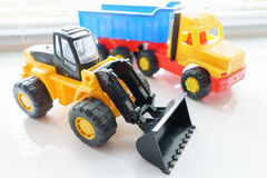 Toy Wheel Loader and Toy Dump Truck Royalty Free Stock Images