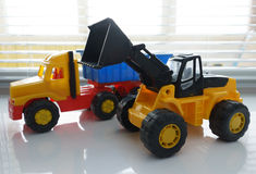 Toy Wheel Loader and Toy Dump Truck Royalty Free Stock Image