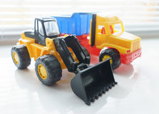 Toy Wheel Loader and Toy Dump Truck Stock Images