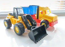 Toy Wheel Loader and Toy Dump Truck Royalty Free Stock Photography