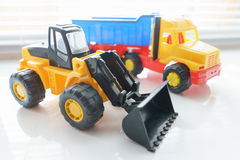 Toy Wheel Loader and Toy Dump Truck Royalty Free Stock Photo