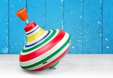 Whirligig for children isolated on wooden. Toy whirligig game leisure color play fun Stock Image