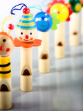 Toy Whistles. A collection of wooden kid toy whistles with different faces royalty free stock photography