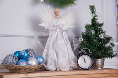 Toy white angel and Christmas tree Stock Photos