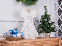 Toy white angel and Christmas tree Stock Photography
