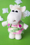 Toy white horse in a gift. Toy white horse on green background. Symbol of year on the Eastern calendar. Gift for holiday. Handmade Felt Stock Photo