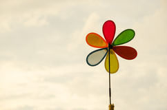 Toy wind turbine and background sky Royalty Free Stock Images