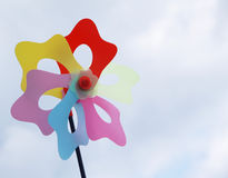 Toy windmill. Colorful toy windmill isolated on a dull blue sky Royalty Free Stock Images