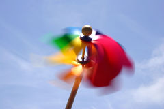 Toy Windmill. Rainbow windmill with blue sky Stock Photography