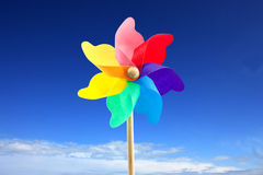 Toy windmill against blue sky Royalty Free Stock Photo