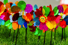 Toy windmill flower. Many toy windmills flowers on the green grass Stock Photos