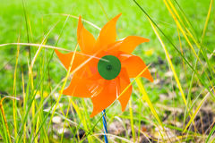 Toy windmill in the grass Stock Photo