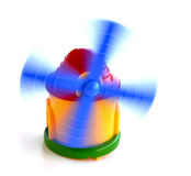 Toy windmill in motion Stock Image