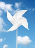 Toy windmill over blue sky. White paper toy windmill over blue sky Royalty Free Stock Photo