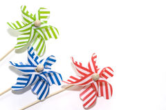 Toy windmills on white background (2). Colorful toy windmills on white background. Studio photography Royalty Free Stock Photo
