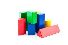Toy wood block multicolor building construction bricks. Toy wood block multicolor building construction bricks isolated on white background stock photo