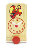 Toy wooden adjustable clock on wheels Royalty Free Stock Photo