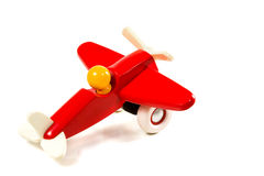 Toy wooden airplane. Children's red plane with a propeller on wheels isolated on white background Royalty Free Stock Images