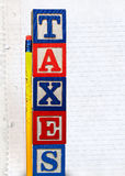 Tax Blocks with chewed pencil Royalty Free Stock Image
