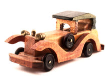 Toy wooden car. A small toy wooden car on a white background royalty free stock image