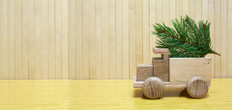 Toy wooden car and christmas tree Royalty Free Stock Photos
