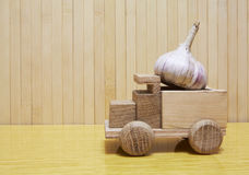 Toy wooden car with garlic Royalty Free Stock Image