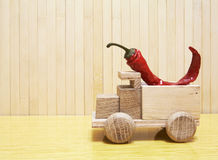 Toy wooden car with red pepper Stock Photo