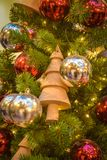 Toy - a wooden Christmas tree on a New Year tree royalty free stock photos