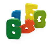 Toy wooden color ciphers, on white Stock Images