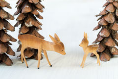 Toy wooden deer and pine cones in the form of christmas trees Royalty Free Stock Photos